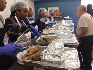 """Volunteers serving Thanksgiving meal"""
