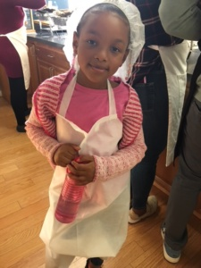 """Young Volunteer helping to serve meals."""